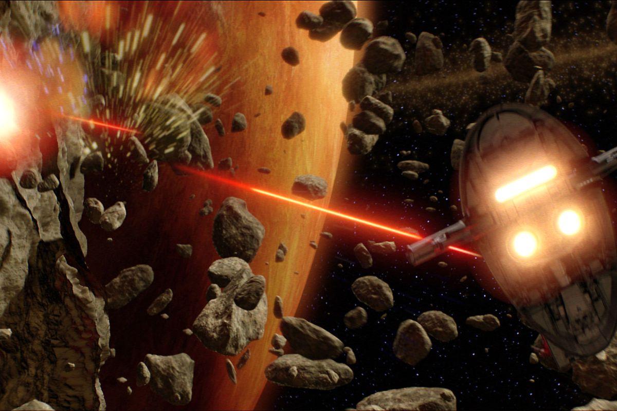 "Jango Fett's Slave I fires its laser cannons at Obi-Wan Kenobi's Jedi starfighter in ""Star Wars: Episode II — Attack of the Clones."""