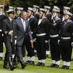 U.S. Defense Secretary Leon Panetta, center, reviews an honor guard during an official ceremony at the Government House in Auckland, New Zealand Friday, Sept. 21, 2012. Panetta become the first Pentagon chief to visit the South Pacific nation in 30 years as the U.S. tries to rebuild military ties that were fractured when New Zealand banned nuclear warships from its shores.