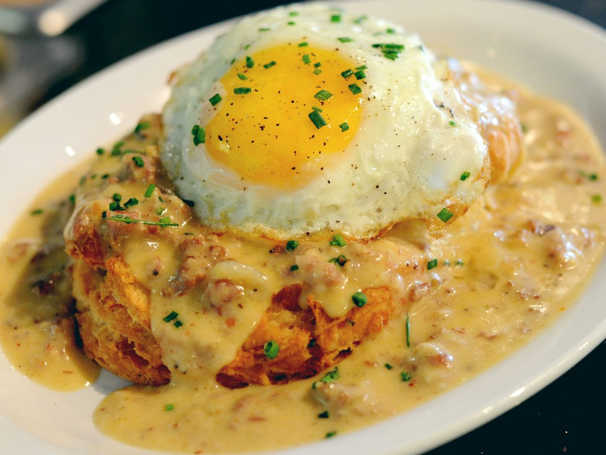 A biscuit smothered with gravy, topped with an egg, at Morsel in the U District.