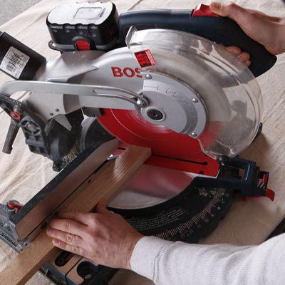 A miter saw being used to create a DIY poker table.