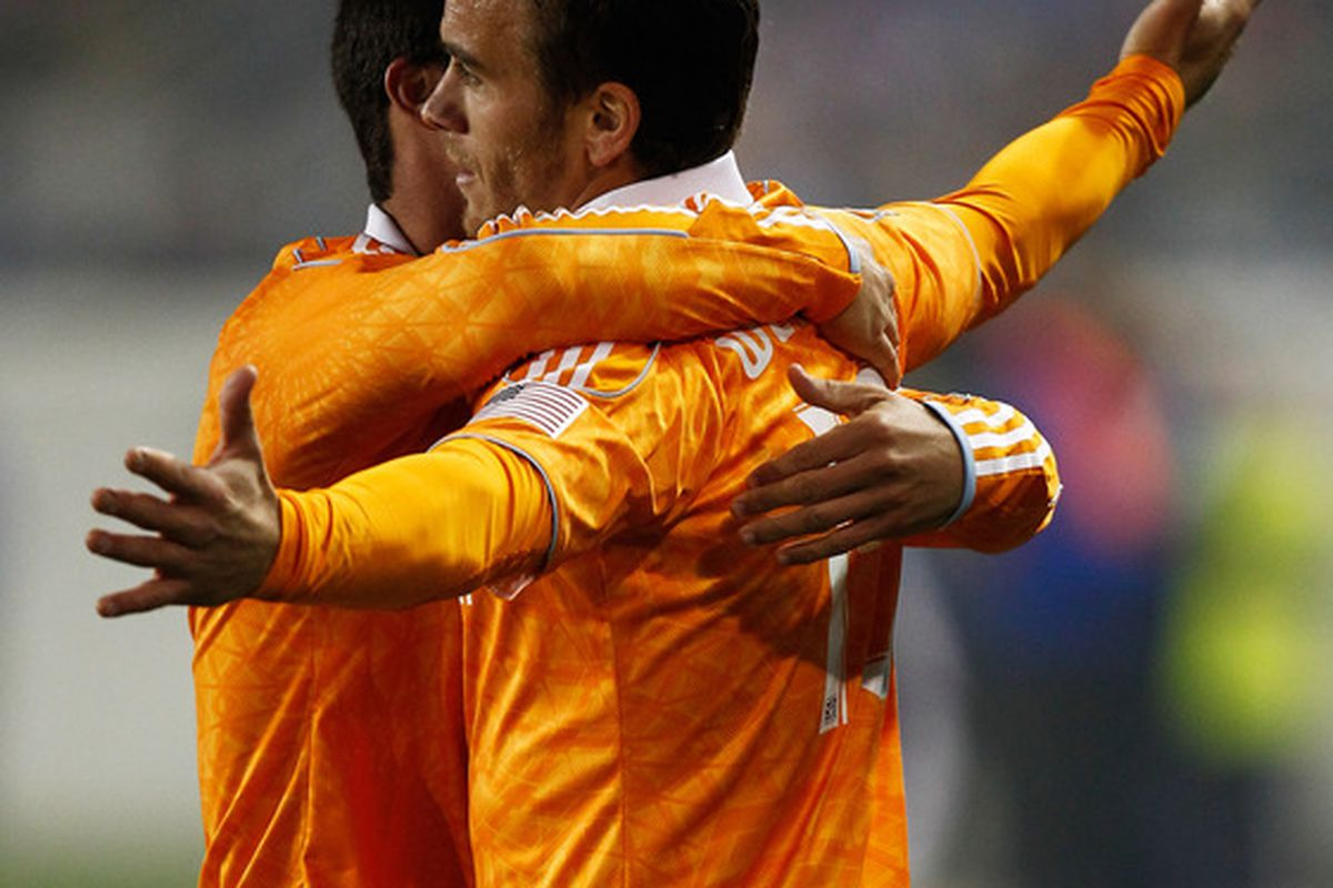HARRISON, NJ - APRIL 02:  Cameron Weaver #15 of the Houston Dynamo celebrates his game-tying goal in the second half against the New York Red Bulls at Red Bull Arena on April 2, 2011 in Harrison, New Jersey.  (Photo by Jeff Zelevansky/Getty Images)