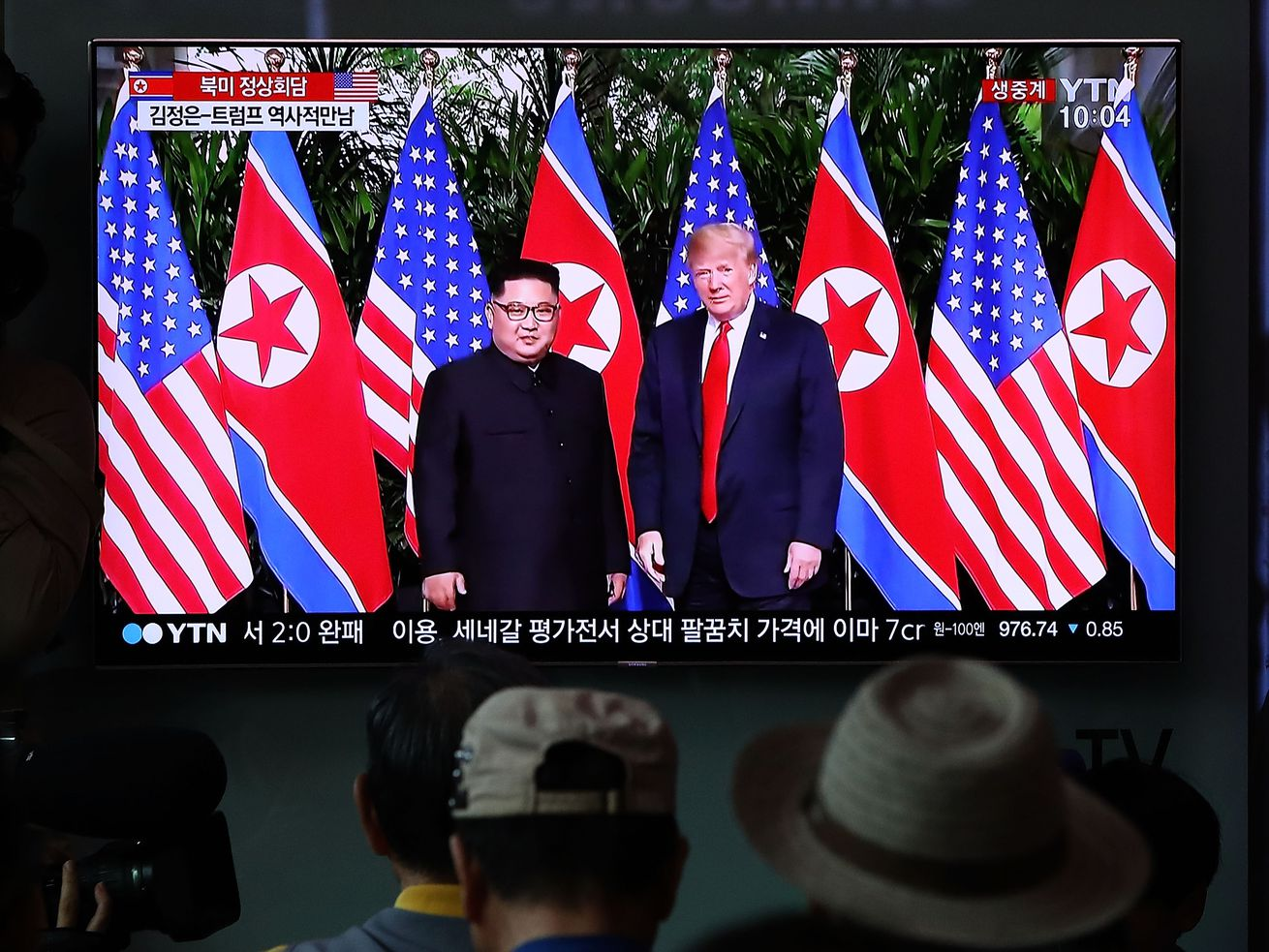 South Koreans watch on screen as US President Donald Trump and North Korean leader Kim Jong Un meet in Singapore in June 2018.