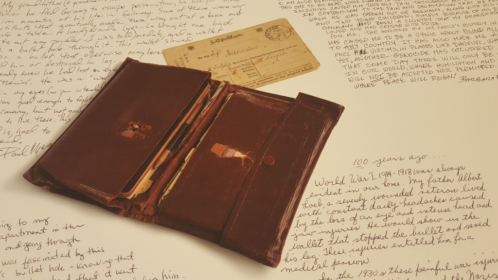 """This wallet was carried by a Jewish soldier in WWI, where it slowed a bullet and saved the life of its owner. It's among the many artifacts/mementos included in the Illinois Holocaust Museum and Education Center's new exhibit """"Stories of Survival: Object,"""