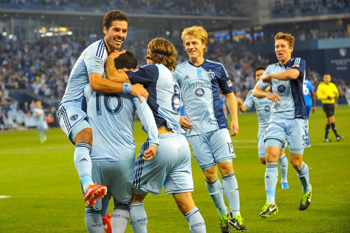 Sporting KC players (L-R) Benny Feilhaber, Claudio Bieler, Graham Zusi, Seth Sinovic and Matt Besler celebrate a goal against Montreal Impact at Sporting Park on March 30, 2013.