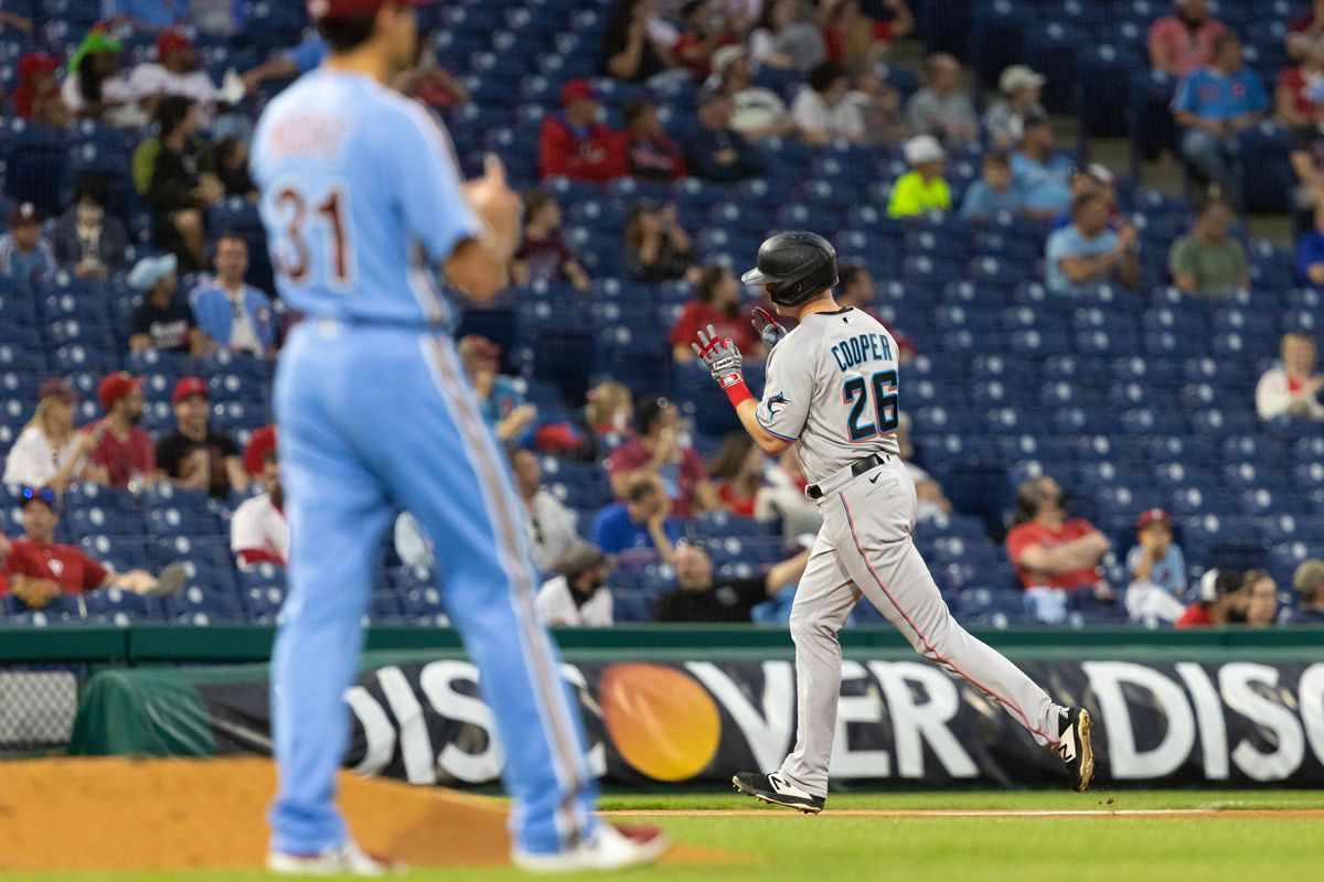 Miami Marlins first baseman Garrett Cooper (26) runs the bases past Philadelphia Phillies starting pitcher Matt Moore (31) after hitting a two-run home run during the fourth inning at Citizens Bank Park.