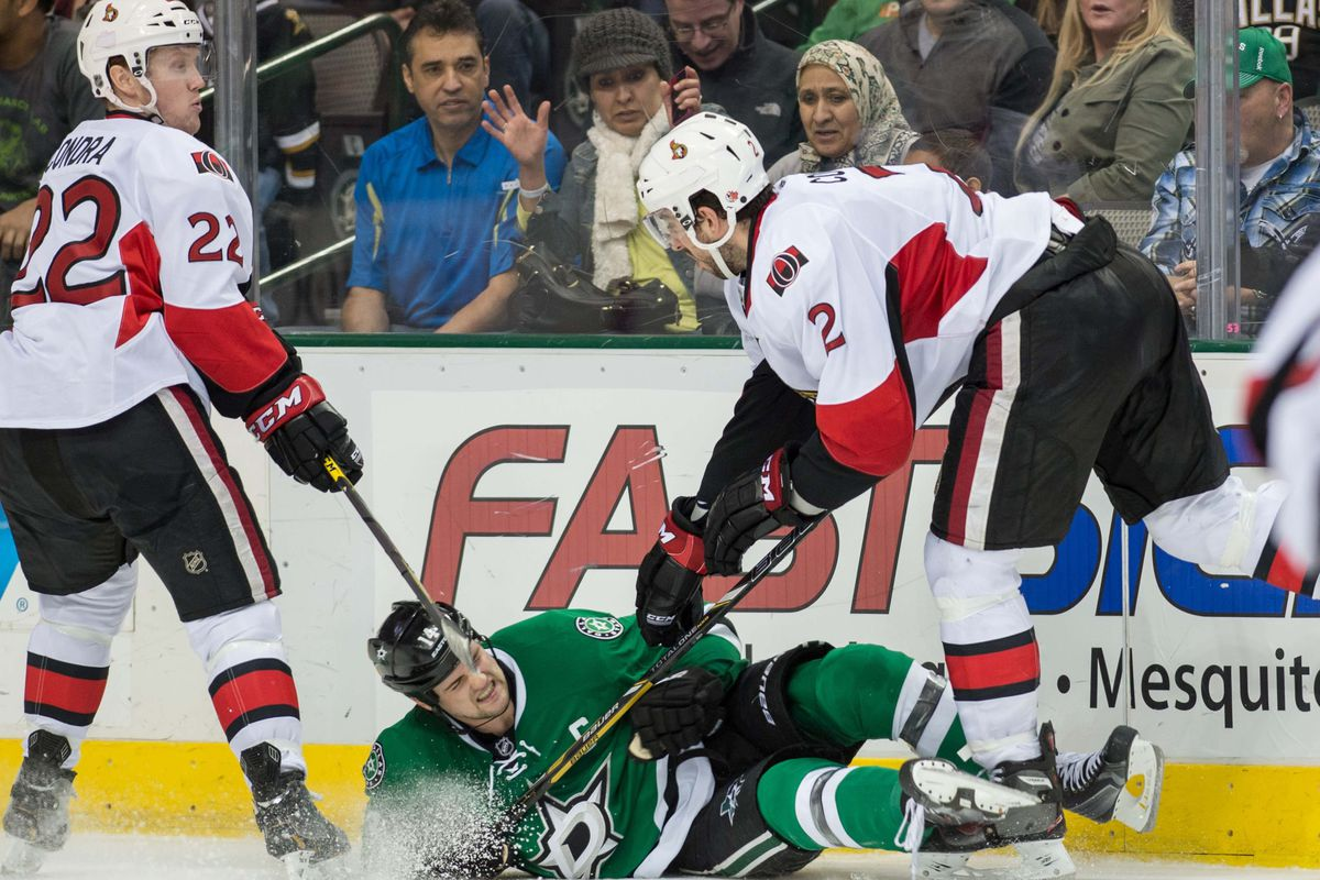 I have no idea where the puck is in this picture, but thankfully none of the players in this picture know either.