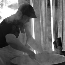 Jake Whitlock, preparing sushi rice with rice wine vinegar and sugar.
