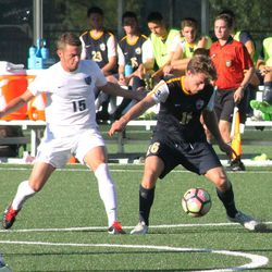 Dakota Peterson shields the ball from Frank Cotroneo