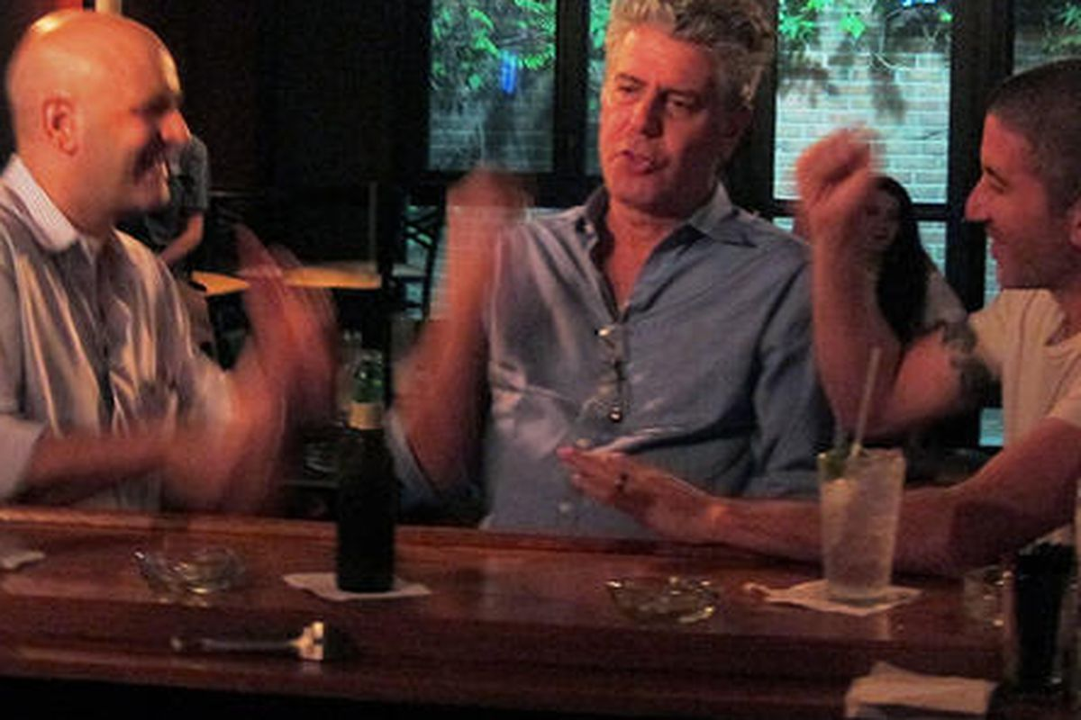 Bourdain, Marc Vetri, and Michael Solomonov play rock paper scissors to see who has to take a shot of hot dog water.