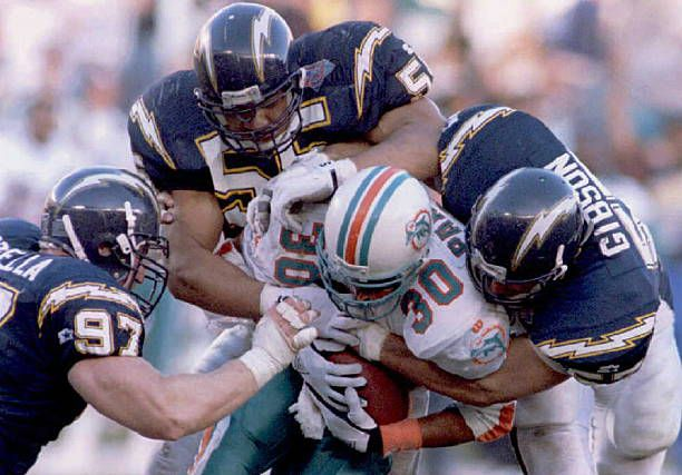 Bernie Parmalee of the Miami Dolphins (C) is gang-tackled by San Diego  Chargers from (L)  John Parrella f6fcd1363