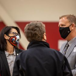 Lt. Gov. Deidre Henderson, left, talks with Canyons School District Superintendent Rick Robins, right, at the district's final COVID-19 vaccination clinic at Mount Jordan Middle School in Sandy on Thursday, March 11, 2021.