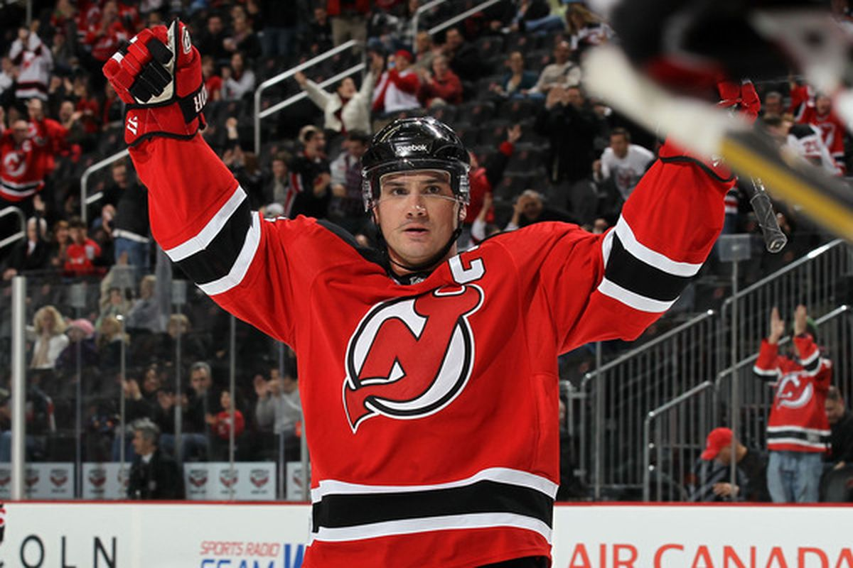 NEWARK NJ - DECEMBER 23:  Jamie Langenbrunner #15 of the New Jersey Devils celebrates his teams goal against the New York Islanders at the Prudential Center on December 23 2010 in Newark New Jersey.  (Photo by Jim McIsaac/Getty Images)