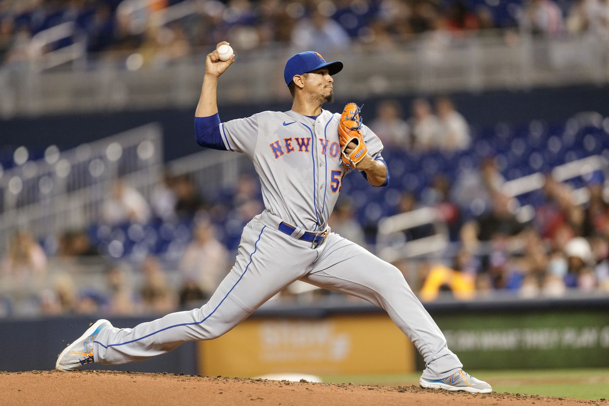 Carlos Carrasco #59 of the New York Mets pitches during the second inning against the Miami Marlins at loanDepot park on September 7, 2021 in Miami, Florida.
