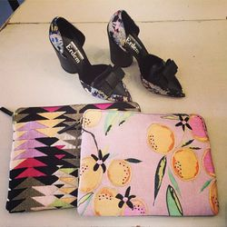 """Printspirational shoes by Erdem, laptop cases by Lizzie Fortunato and Nicholas Kirkwood. Image via @satineboutique/<a href=""""http://instagram.com/p/jH7I6gN0j1/"""">Instagram</a>"""