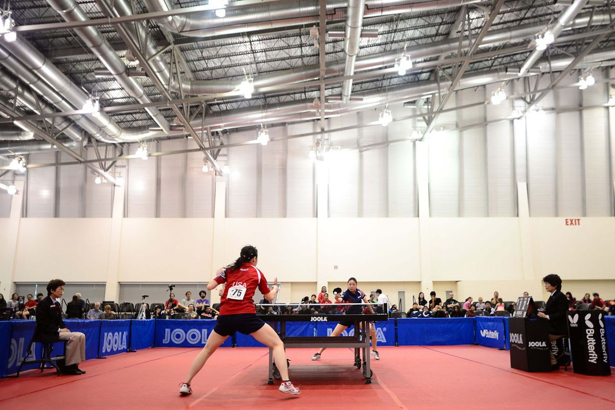 Jul. 4, 2012; Grand Rapids, MI, USA; Ariel Hsing (USA), in red, plays in the womens singles semifinals against Lily Zhang (USA) in the 2012. U.S. Open  at DeVos Place. Mandatory Credit: Andrew Weber-US PRESSWIRE