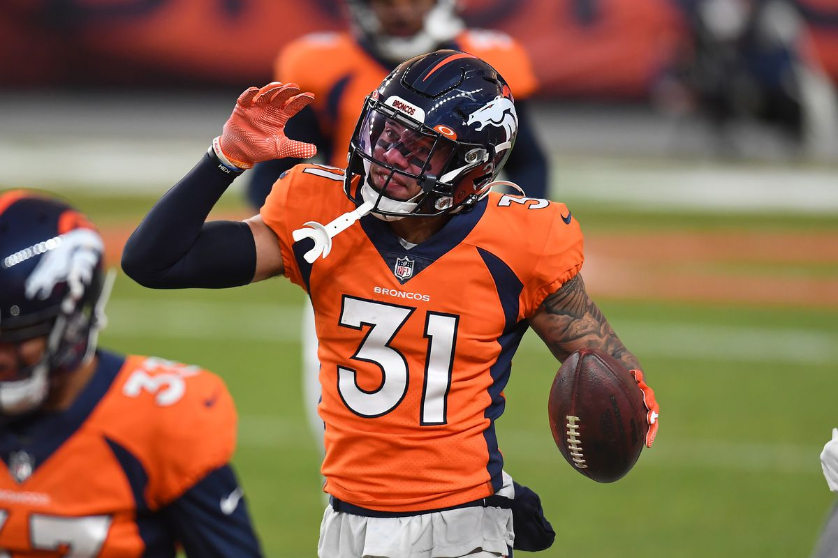 Denver Broncos free safety Justin Simmons (31) celebrates his interception in the fourth quarter against the Las Vegas Raiders at Empower Field at Mile High.