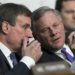 Senate Intelligence Committee Vice Chairman Mark Warner, D-Va., left, confers with Chairman Sen. Richard Burr, R-N.C., as the panel questions top national security chiefs about the gathering of intelligence on foreign agents, on Capitol Hill in Washington, Wednesday, June 7, 2017.