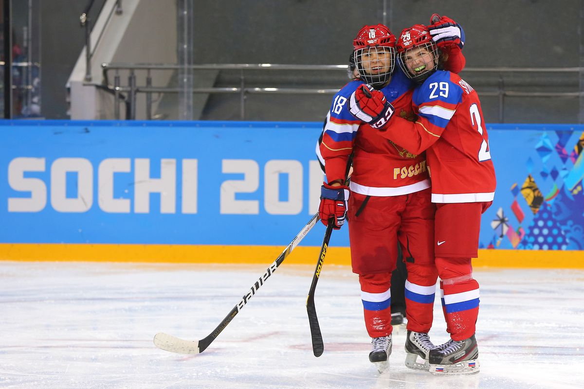 Olga Sosina #18 of Russia celebrates her goal with Anna Shokhina #29 of Russia during a match against Japan at the Sochi 2014 Winter Olympics.