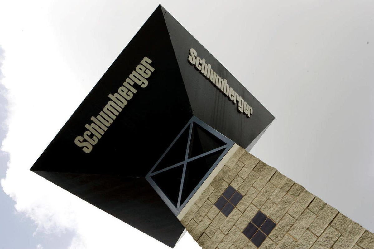 FILE - This Oct. 18, 2007, file photo shows a Schlumberger logo on a tower at the entrance to Schlumberger's Sugar Land, Texas campus.