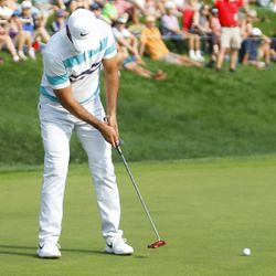 Jason Day putts on the 18th hole in the 2019 Travelers Championship Third Round at the TPC River Highlands in Cromwell, CT on June 22, 2019.