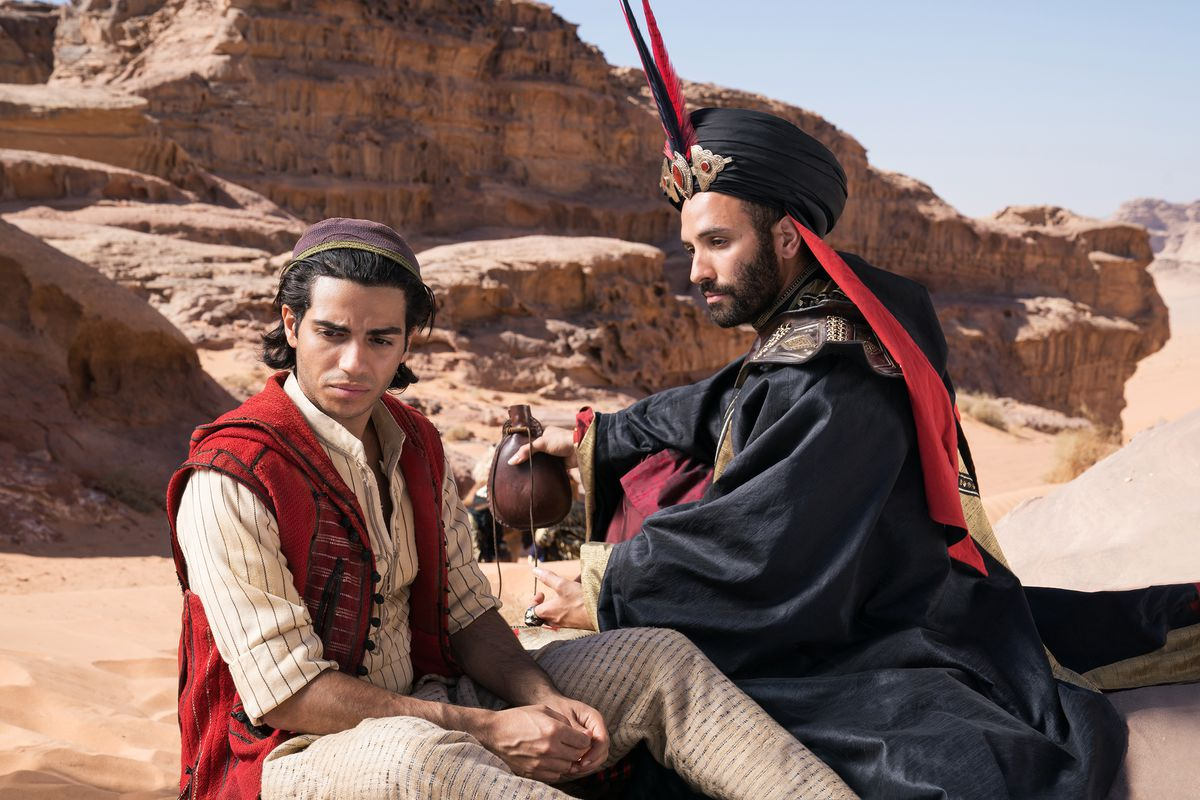 aladdin and jafar sit in the middle of the desert talking about their plan to steal the lamp