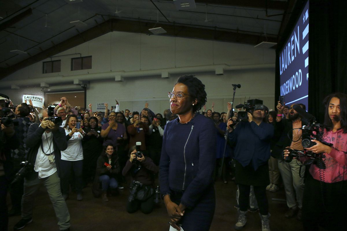 Lauren Underwood at a victory party surrounded by crowds