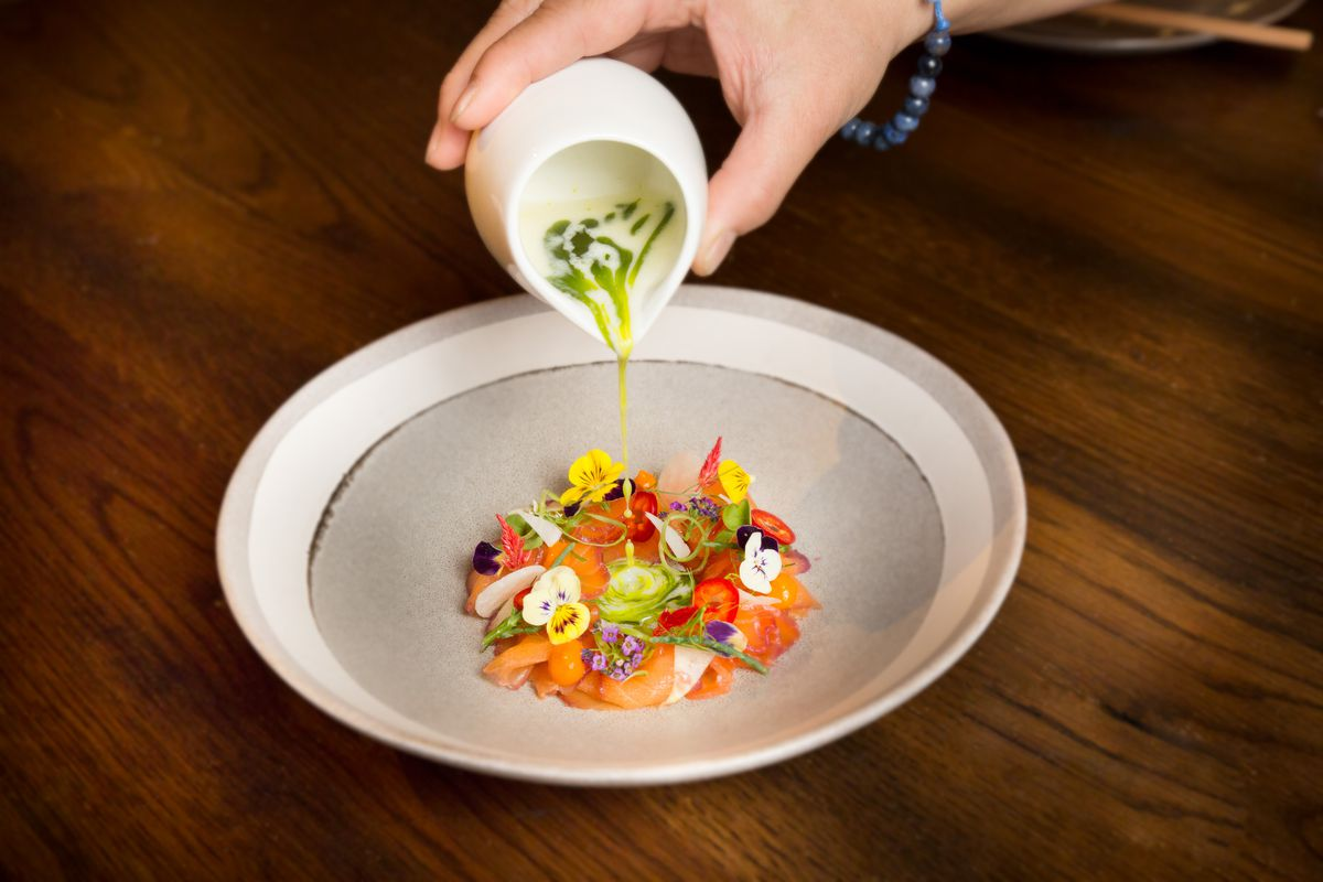 Beet cured salmon ceviche with coconut leche de tigre and mint oil at Once