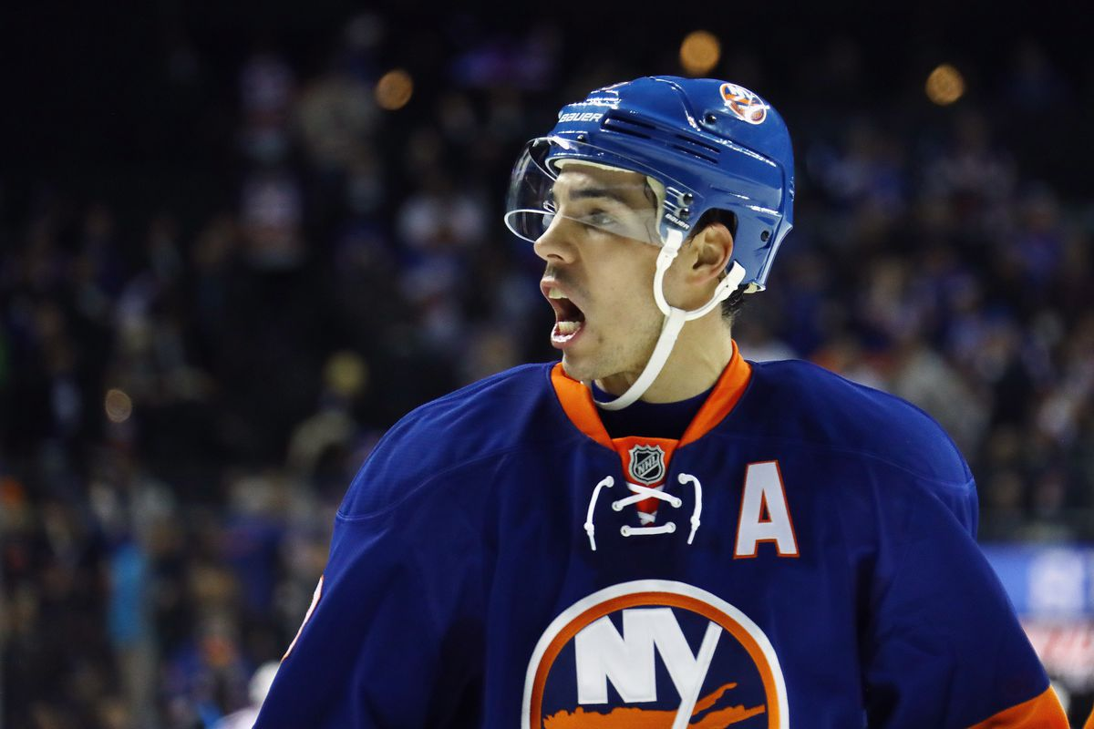 Flames acquire defenceman Travis Hamonic, picks in trade with Islanders