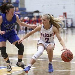 Richfield's Passion Reitz dribbles around Carbon's Abbie Saccomanno during the 3A girls basketball quarterfinals at the Lifetime Activities Center in Taylorsville on Thursday, Feb. 20, 2020. Richfield won 50-36.