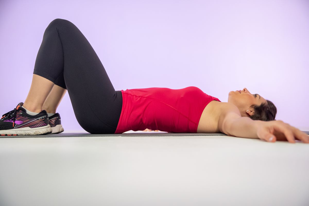 Lying on your back with your feet on the ground and knees as wide as your hips, relax your body. As you breathe in, fill your stomach up to achieve a Pelvic Tilt. Health and fitness expert Stephanie Mansour demonstrates proper pilates technique.   Brian E