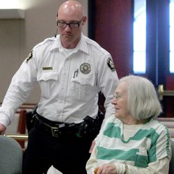 A Uintah County sheriff's deputy helps Evelyn Christine Johnson, 75, get into her seat at the defense table stands prior to her sentencing hearing Thursday, Feb. 9, 2012. Johnson was sentenced to one to 15 years in prison for fatally shooting her husband, Alan Lavoy Johnson, in August 2004. She was initially charged with murder, a first-degree felony, but pleaded guilty in December 2011 to manslaughter, a second-degree felony.