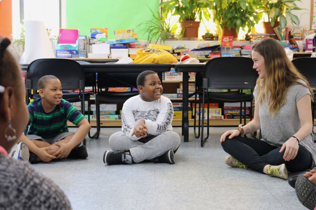 Homeless students participate in an afterschool reading club.