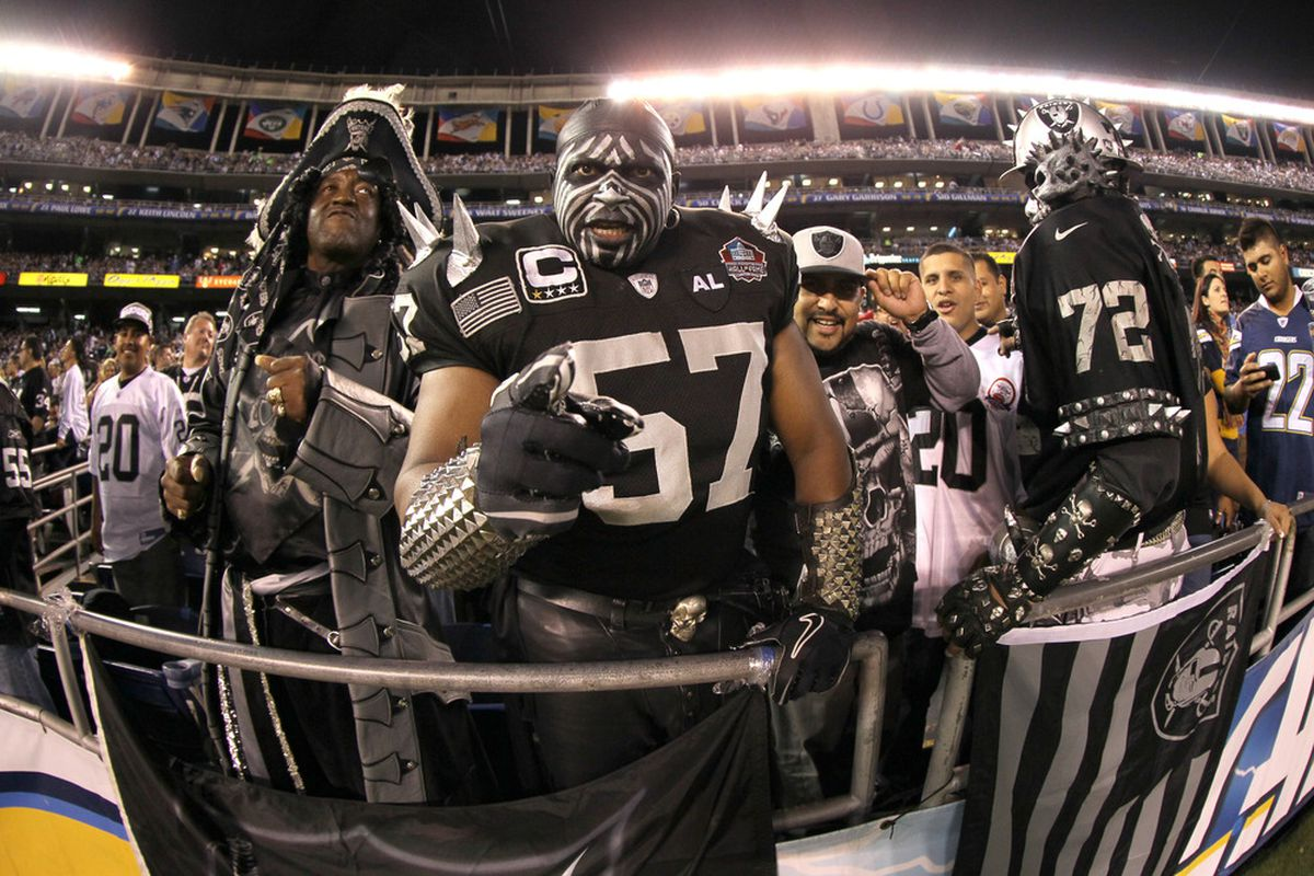 SAN DIEGO, CA - NOVEMBER 10:  Costumed Oakland Raiders fan cheers in the game against the San Diego Chargers at Qualcomm Stadium on November 10, 2011 in San Diego, California.  (Photo by Stephen Dunn/Getty Images)