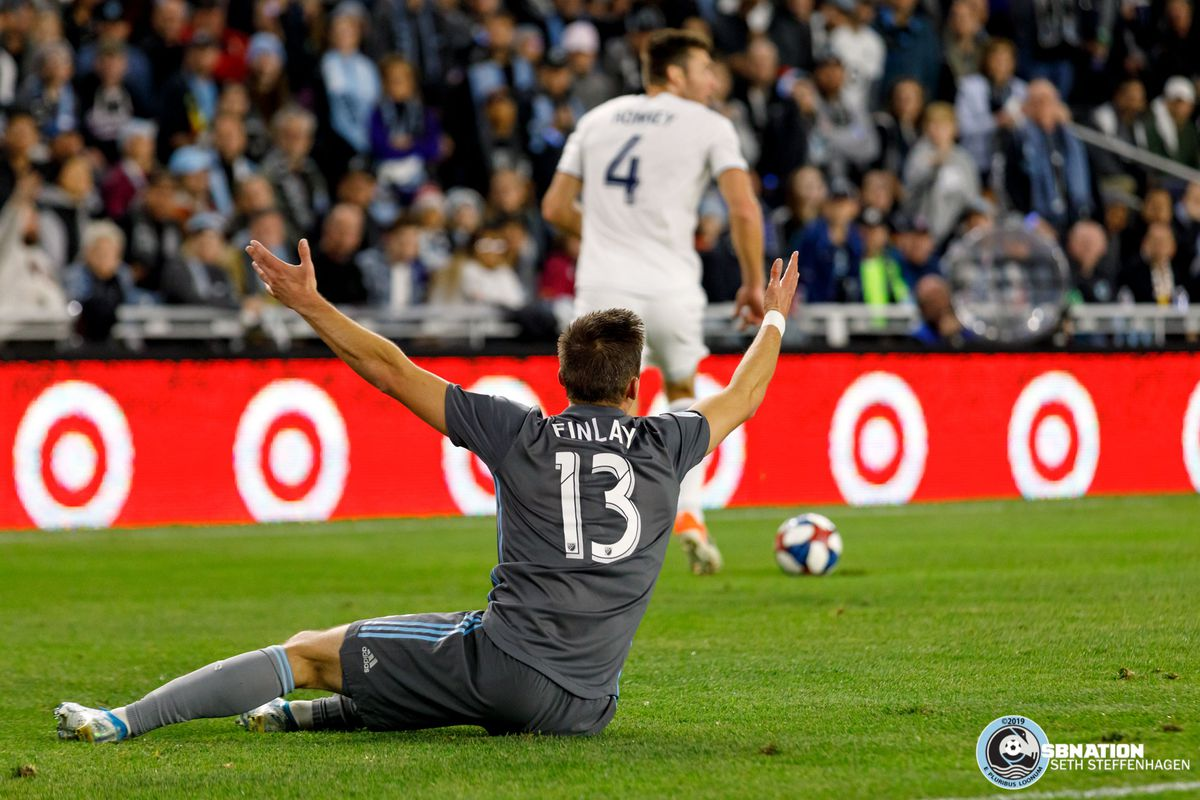 October 20, 2019 - Saint Paul, Minnesota, United States - Minnesota United midfielder Ethan Finlay (13) looks for a foul against him during the Minnesota United vs LA Galaxy 1st round playoff match at Allianz Field.