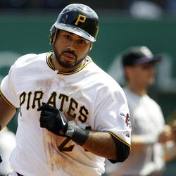 Pittsburgh Pirates' Pedro Alvarez rounds third after hitting a solo-home run off Colorado Rockies pitcher Juan Nicasio in the seventh inning of a baseball game in Pittsburgh, Wednesday, April 25, 2012. The Rockies won the first game of a double header 2-1.