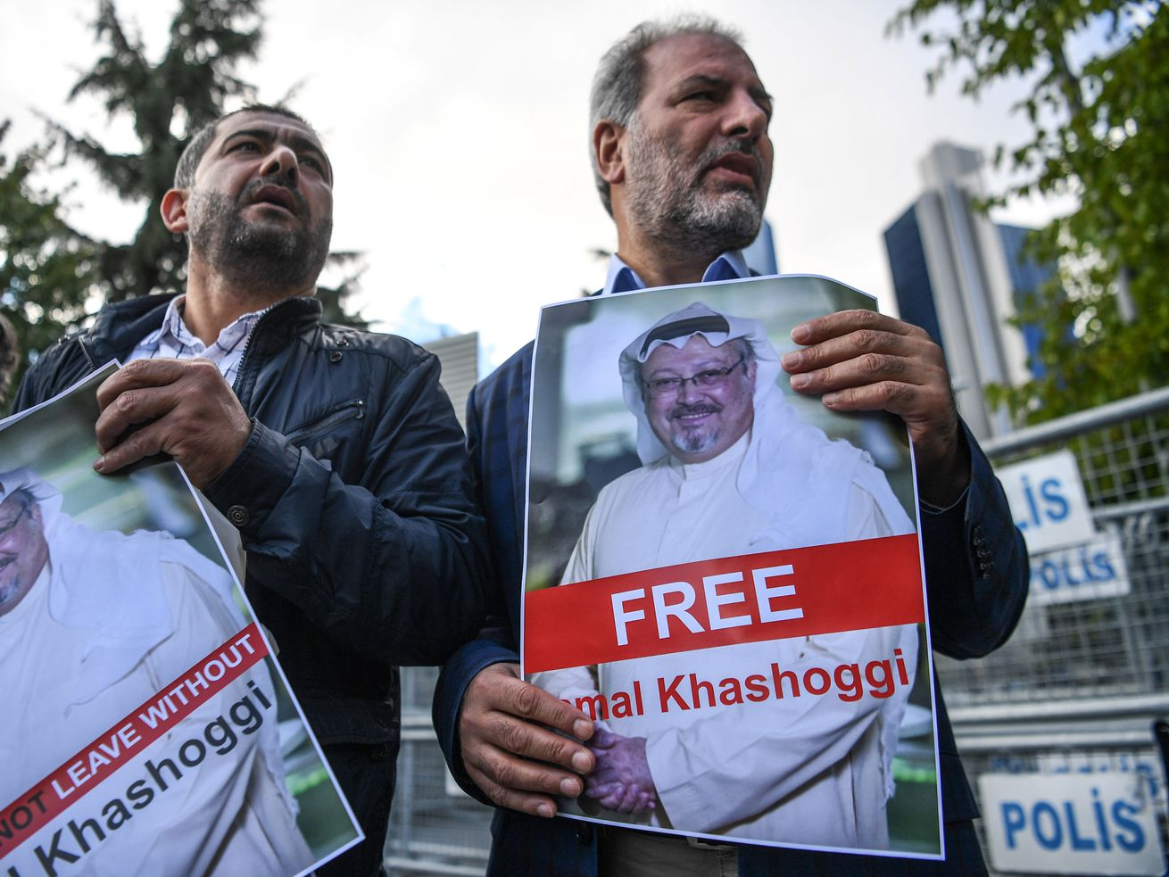 Protesters hold pictures of missing Saudi journalist Jamal Khashoggi during a demonstration in front of the Saudi Arabian Consulate on October 5, 2018, in Istanbul.