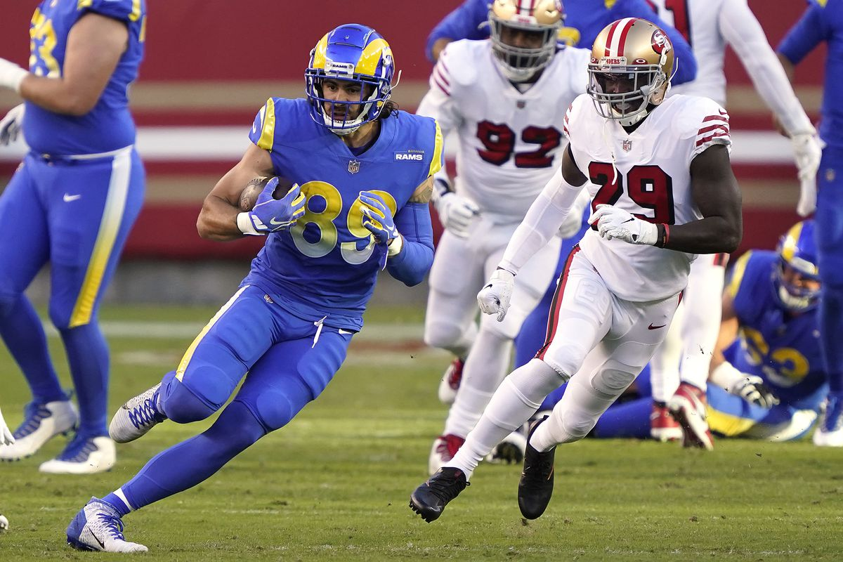 Tyler Higbee #89 of the Los Angeles Rams runs for a first down against Jaquiski Tartt #29 of the San Francisco 49ers during the first quarter at Levi's Stadium on October 18, 2020 in Santa Clara, California.