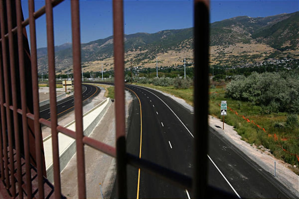 """FILE"""""""" A view of the four-lane, 14-mile-long Legacy Parkway from near the onramp and offramp west of the Parrish Lane interchange."""