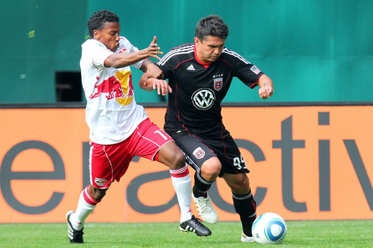 WASHINGTON - MAY 1: Jaime Moreno #99 of D.C. United dribbles against Danleigh Borman #11 of the New York Red Bulls at RFK Stadium on May 1, 2010 in Washington, DC. (Photo by Ned Dishman/Getty Images)