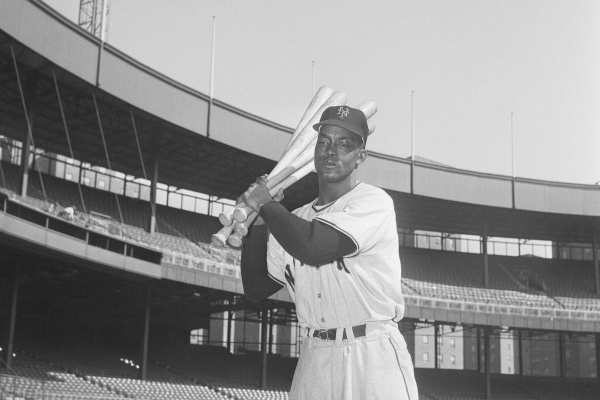 Monte Irvin Holding Baseball Bats