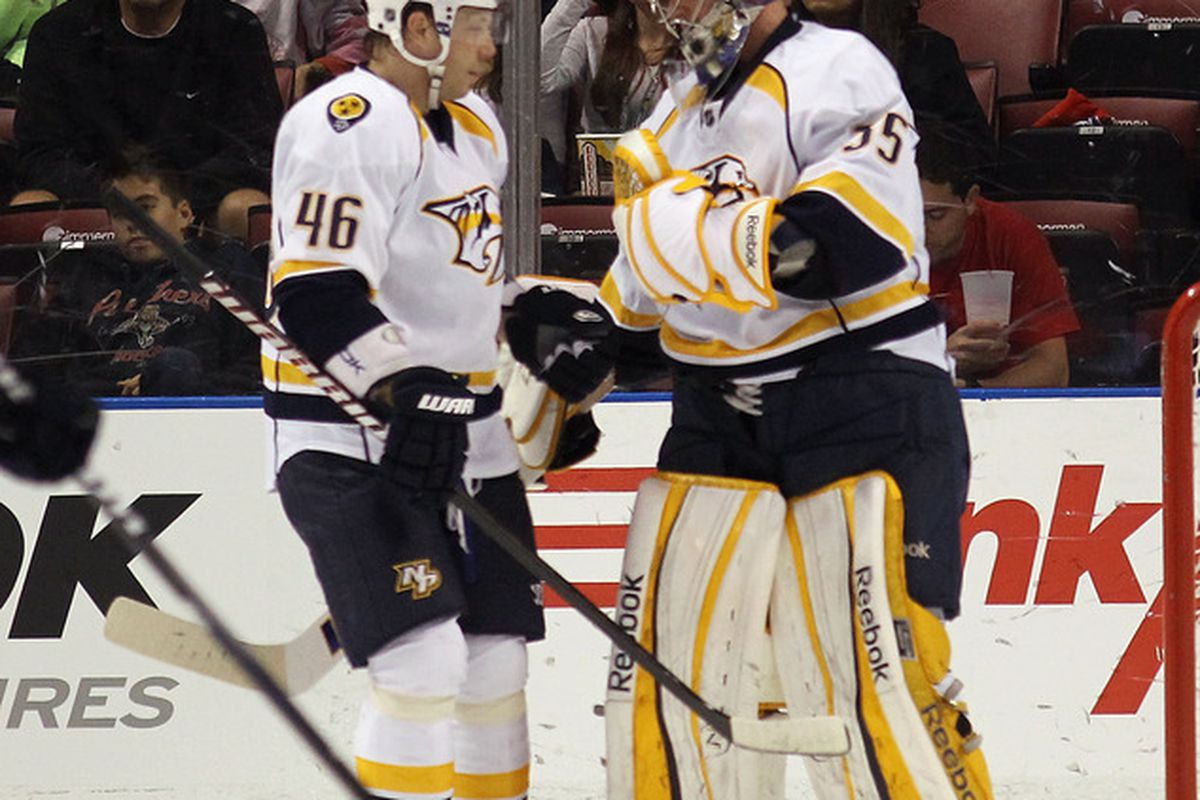 SUNRISE, FL - MARCH 03: Andrei Kostitsyn #46 and Pekka Rinne #35 of the Nashville Predators celebrate their 3-1 victory over the Florida Panthers at the BankAtlantic Center on March 3, 2012 in Sunrise, Florida.  (Photo by Bruce Bennett/Getty Images)