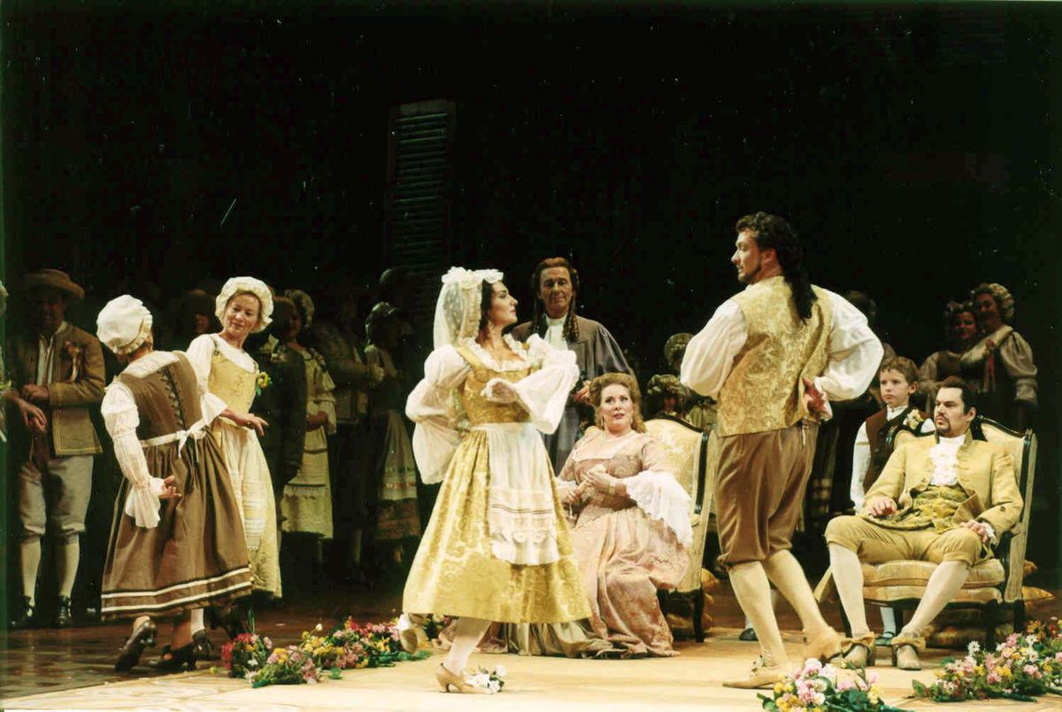 """The wedding dance scene in Sir Peter Hall's production of """"The Marriage of Figaro"""" at Lyric Opera of Chicago during the 2003-2004 season. (Photo: Dan Rest/ Lyric Opera of Chicago.)"""