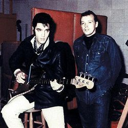"""in this undated photo released by Sony Music, Elvis Presley is shown with Chips Moman, right, at American Sound Studio in Nashville, Tenn. Moman ran the studio and produced sessions for Presley. Among the recordings that came out of American Sound Studio was Presley's last No. 1 hit, """"Suspicious Minds."""""""