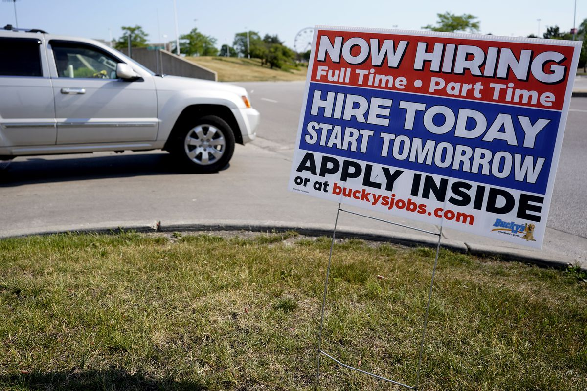 A hiring sign shows in Vernon Hills, Ill., Friday, June 11, 2021. Barely more than a year after the coronavirus caused the steepest economic fall and job losses on record, the speed of the rebound has been so unexpectedly swift that many companies can't fill jobs or acquire enough supplies to meet a pent-up burst of customer demand.