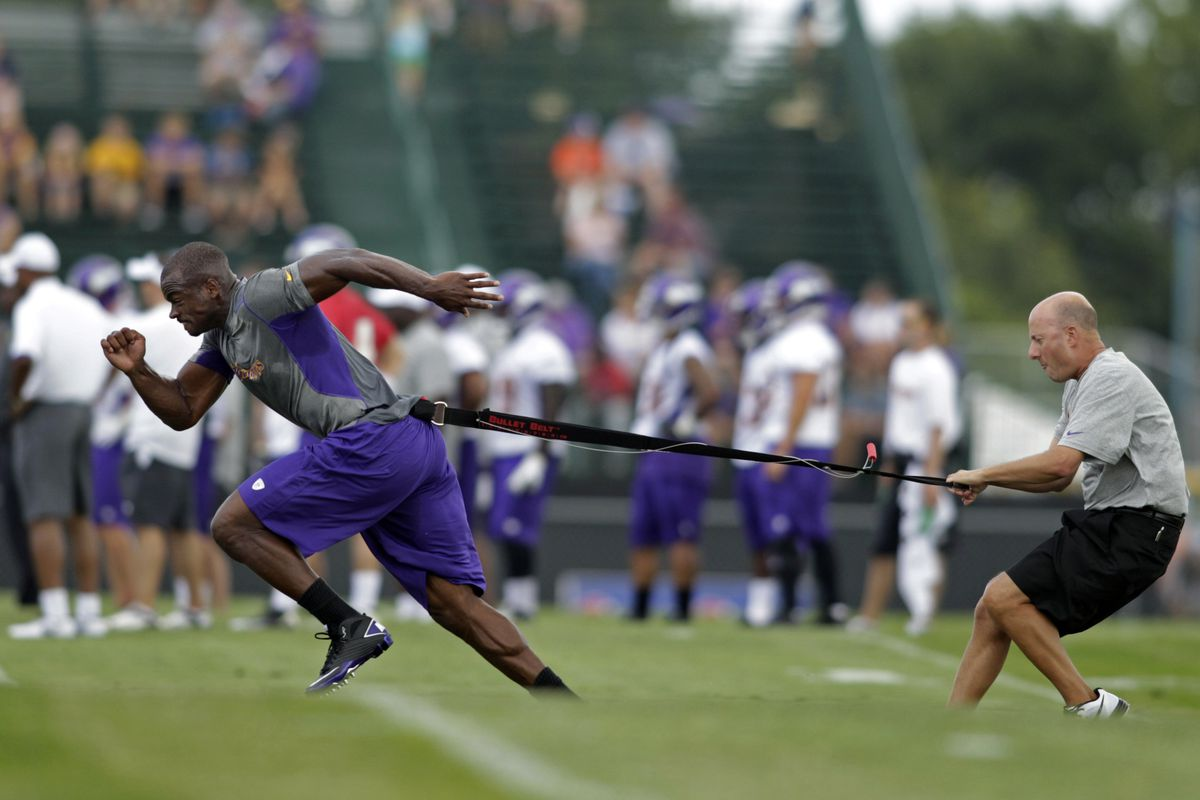 Eric Sugarman teaches Adrian Peterson to fly. Oh, Sugarman is the one on the right.
