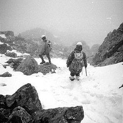 Mike Ermarth, front, and Rick Reese hike on the snowy Petzoldt Ridge on the south side of the Grand Teton in June 1965.