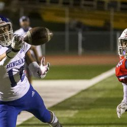 Bingham's Isaiah Glasker stretches for the ball in front of East's Mapa Vaenuku during game at East High School in Salt Lake City on Friday, Sept. 25, 2020. Glasker couldn't come up with the ball on the play.
