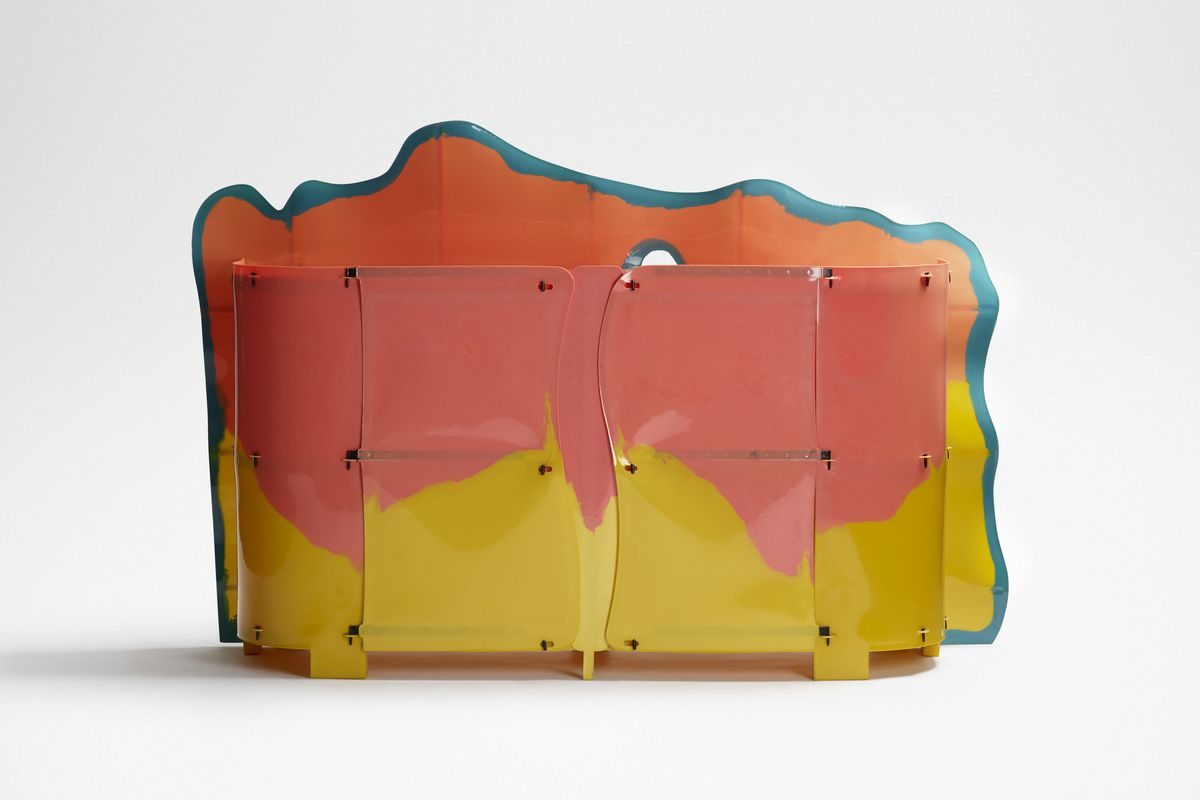 A cabinet with cloud-like frame behind it, rendered in bright colors.
