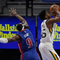 Utah Jazz guard Donovan Mitchell (45) makes a layup as Detroit Pistons forward Jerami Grant (9) defends during the second half of an NBA basketball game, Sunday, Jan. 10, 2021, in Detroit.