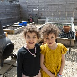 Hilde and Elsie Shapiro-Braddy pose in their garden, Tuesday, April 28, 2020.